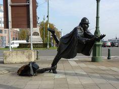 """Policeman being tripped"" by Tom Frantzen | Brussels, Belgium."
