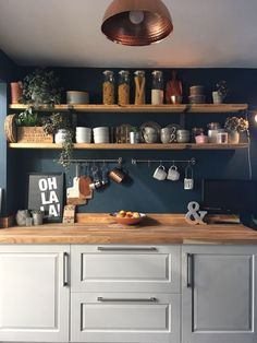 Laura has used Hague Blue on her Kitchen walls as a backdrop to her rustic shelves. The combination of wood, plants, copper and greys against the blue works beautifully here decor colour Dark blue walls. Kitchen Wall Colors, Home Decor Kitchen, Rustic Kitchen, Kitchen Interior, New Kitchen, Home Kitchens, Blue Walls Kitchen, Decorating Kitchen, Hague Blue Kitchen