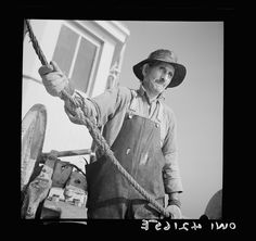 On board a fishing vessel out from Gloucester, Massachusetts. One of the fishing crew Photographer Howard Liberman Created September 1942