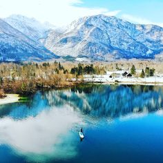 """""""It's called lake """"Bohinj"""" in slovenia. It's about 20 minutes by car from little city of bled. It was just great fun to on it. And the view was just amazing. Windshield Cleaner, Bohinj, Bed Bugs, Beautiful Scenery, Paddle Boarding, Cool Photos, Places To Visit, Heaven, Cooking Recipes"""