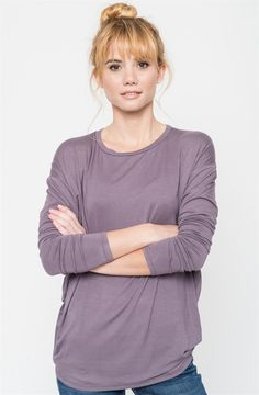 Live-in-it soft and perfectly draped, this polished, long-lasting dolman top fashioned in every color of the the color chart is perfect for your everyday layering piece. Pair it with almost any cardigan, jacket, with your everyday leggings for a polished look for every season of the year.COLORS IvoryTaupePurplePeachSageBlackBlueSIZES (This garment runs true to size) Small 0-4Medium 6-8Large 10-12Model is wearing a size Small.96% Rayon, 4% Spandex.Made in USA.