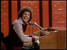 "This is one of Albert Brooks's best sketches, ""Rewriting the National Anthem.""  It's an edited-down version for ""The Flip Wilson"" TV show, so some of the humor is lost, but there's plenty enough left. -- RJE"