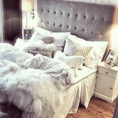 I love this tufted bed with white bedding and white quilted pillows & silver decorative pillows.