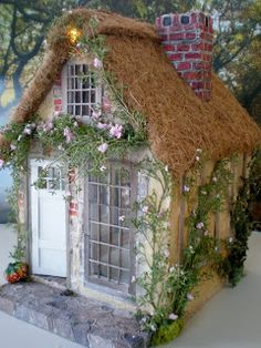 Cottage dollhouse - many photos of the details and discussion of how she made parts of it - (she also has a book on building dollhouses, might want this!) from Cinderella Moments: Marie Antoinette Cottage Dollhouse