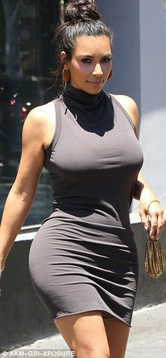 Kim Kardashian squeezes her shapely rear into a tailored turtleneck dress after weight loss | Daily Mail Online