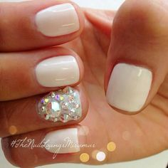 White with a crystal ring finger.