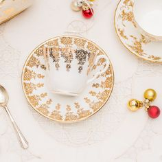 Lovely vintage gold and white tea cup and saucer by TheButteredCat