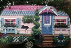 Serro Scotty vintage camper trailer!  THE best paint job I've ever seen!!  Love the porch and the cat!  Artist ~ L. Risor of Texas, for Sisters on the Fly.
