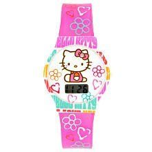 "Hello Kitty LCD Watch by Hello Kitty. $29.94. This Hello Kitty digital watch, dial has a Hello Kitty Graphic on white background, pink plastic strap with hearts and flowers, ""Hello Kitty"" text written around case in turquoise, pink, orange, and hot pink.Hello Kitty is a cheerful and happy girl with a heart of gold. Kitty can bake delicious cookies, but she loves Mama's apple pie even more. Her best friend is her twin sister Mimmy. They have lots of friends at schoo..."