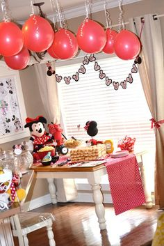 Cute Minnie party, posting for a few decor ideas...also love the balloons hanging from ceiling, will have to try that...the topiaries are awesome and floral arrangements.  Simple foam balls.  Cute cute.