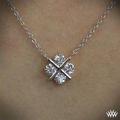 "XO Diamond Pendant Cross our hearts...and arrows diamonds. The ""XO"" Diamond Pendant shines with 4 A CUT ABOVE® Hearts and Arrows Diamond Melee"