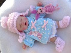 Polymer Clay Baby made by my friend Kimberly Wilfong and her piglet toy made by me! :)