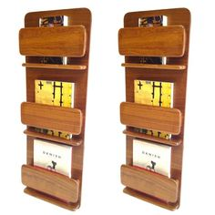Pair of Peter Pepper Danish Modern Style Wall Mount Book Magazine Holders   From a unique collection of antique and modern magazine racks and stands at http://www.1stdibs.com/furniture/more-furniture-collectibles/magazine-racks-stands/