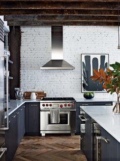 Cottage Kitchen with Ms international carrara white marble, Painted brick wall, Multiple Refrigerators, Kitchen island, Flush