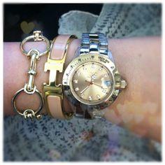 Today's arm party: Banana Republic horsebit bracelet, Hermes Clic H bangle, rose gold Toywatch.