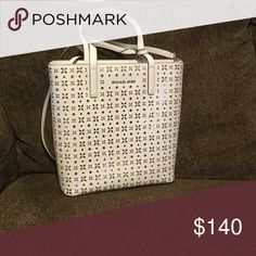 """Michael Kors Cutout Tote NWT. White with silver cutouts , zip closure, 14""""W x 13.5""""H x 4.75""""D, leather, top carry handles, one crossbody strap, Michael Kors Bags Totes"""