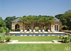 The pool, dining pergola, and kitchen pavilion at a late-19th-century house in Virginia's Hunt Country.