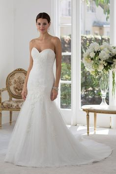 Lace sweetheart neckline with cold shoulder sleeves delicately beaded on a fit and flair style gown, dramatic keyhole back with a court length train. Back closing: Zip Fabrics: Tulle/Heavy Lining A Line Bridal Gowns, White Wedding Gowns, Stunning Wedding Dresses, Designer Wedding Gowns, Bridal Dresses, Tulle Lace, Lace Bodice, Prom Boutiques, Bonny Bridal
