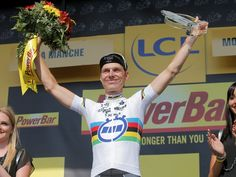 Tony Martin celebrates on the podium after winning the 11th stage of the Tour de France, an individual time trial of 33 kilometers that started in Avranches and finished in Mont-Saint-Michel.  Christophe Ena, AP