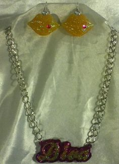 Handmade 2 layer Hot Pink/Yellow Diva Glitter Resin Pendant on 18in Silver Chain and 2 in extender. Handmade Yellow Glitter Resin Lip Earrings Embellished with Hot Pink Stone. Custom Drilled Holes. One-Of-A-Kind $20