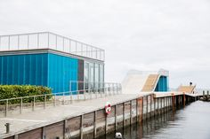 A team led by JDS Architects has designed a landscaped waterfront recreation area of Faaborg with slides on top of small buildings. Covered Walkway, Covered Decks, Colour Architecture, Landscape Architecture, Deck Design, House Design, Temporary Architecture, Bath Pictures, Temporary Structures