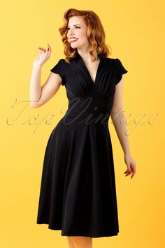 This50s Claudette Swing Dressis a fantastic fifties inspired dress that is perfect for the upcoming season!  The top features short sleeves with a playful wrap-over detail andan elegant V-necklinefor a pin-up touch: pleated at the bust and therefore suited for all cup sizes. Made from a lovely, supple, black fabric with a light stretch. Thisclassic yet sexy style can easily take you from work to cocktails to dinner, the possibilities...