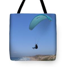 This handy tote bag shows a paraglider soaring over the dunes above Monterey Bay at sand City, California. Image by James B. Toy, tote bag by Pixels.com.