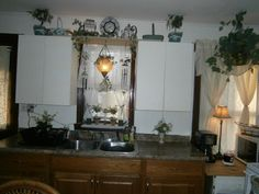 old farm house kitchen, what to do with these old metal cabinets???