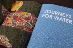 Journeys for Water | PaperSpecs. A special tip of the hat goes to MET Fine Printers for an admirable job on making saddle stitching 62 pages look easy (think wicked push out).