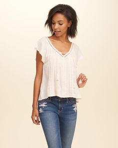 For a pretty and feminine look, try this flowy top with flutter sleeves, sweet…