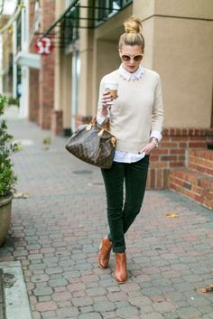 With white shirt, creme sweatshirt and green pants