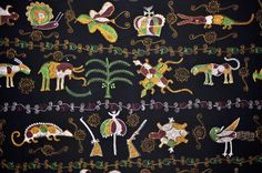 Africa | Detail from an Ashanti akunitan (cloth of the great ) made in the 1960s in Ghana | Akunitan are traditional wool fabric cloths with designs and proverbs of the Ashanti tribe. | The designs were made using hand embroidery.