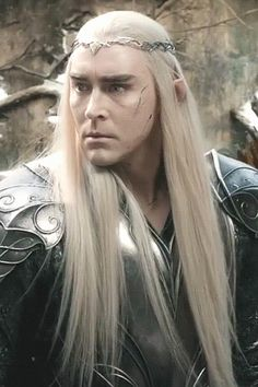 Thranduil, the blood of his soldiers on his face.and hands.