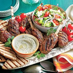 Spiced Beef Kabobs with Herbed Cucumber and Tomato Salad | MyRecipes.com Serve this zesty beef with toasty bread and a tangy herb salad.