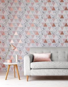 Copper and pink triangular wallpaper is spot on for the geometric interior trend.