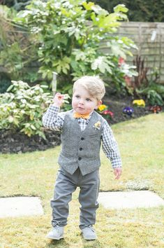 Little page boy in grey suit, waistcoat and yellow bow tie. So cute!  http://sdsphotography.co.uk/