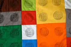 Close-up of the lego quilt.  Stamped using a carvable eraser and permanent ink, and stitch in the ditch quiliting.  www.weewonderfuls.com