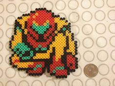 Samus Aran from Metroid. Made from perler beads.