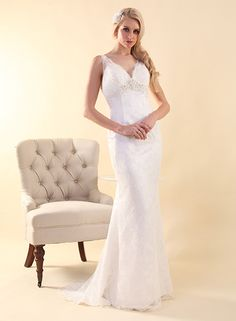 Peter Trends style LV 5267 is a delicate lace gown with plunging back