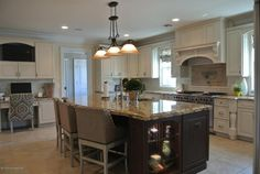 Traditional Kitchen with Crown molding, Custom hood, Ballard Design Marcello Counter Stool with Pewter Nailhead Trim