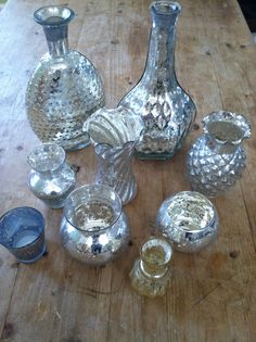 Vintage Mercury vases. These can also bring sparkle and uniqueness to each center piece.  without going tacky