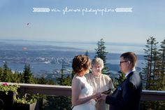 A summer wedding ceremony on the Timber Room deck high above the city at Grouse Mountain. | Photographer: Erin Gilmore Photography
