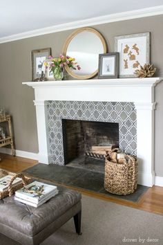 Fireplace decorated for spring with round IKEA mirror, inexpensive art printables, and spring tulips Idea for tiling in living room Fireplace Tile Surround, Home Fireplace, Fireplace Remodel, Living Room With Fireplace, Fireplace Surrounds, Fireplace Design, My Living Room, Home And Living, Living Room Decor