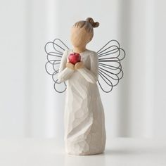"""$12.17-$13.99 Willow Tree You're The Best Angel Figurine by Susan Lordi, 26248 - New! Willow Tree You're The Best Angel  Figurine by Susan Lordi. 5.5"""" high. Resin and metal. Gift boxed. Angel figure holding a shiny red apple. """"Thank you for making a difference""""  Since 2000, Susan Lordi has been creating these figurative sculptures that speak in quiet ways of deep emotion and inspiration.  Artist  ..."""