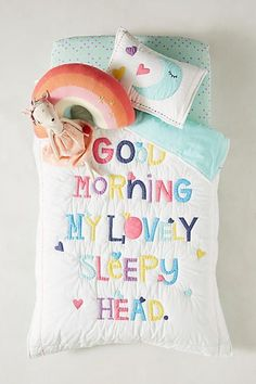 Known for her bright embroidery and witty screen prints, Rachel Castle designs vibrant pieces that communicate her joyous, playful approach to everyday life. #kidsroom #quilt #goodmorning #bedroom #affiliate