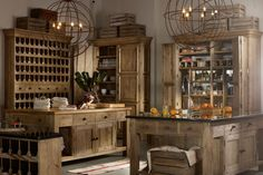 """Two large free-standing islands, two large cabinets and two pretty impressive wine racks - you may not have the space for these striking pieces of furniture in your kitchen but we still say get inspired by the rich wood scheme and antique bronze light fittings.   Timothy Oulton Kitchen from [link url=""""http://www.barkerandstonehouse.co.uk""""]Barker & Stonehouse[/link]  [link url=""""http://www.houseandgarden.co.uk/homes/decorating-tips""""]101 decorating ideas[/link][link…"""