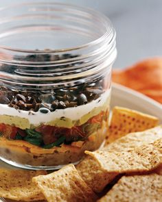Brilliant! 7 layer dip in little mason jars...perfect for individual appetizers! No worries about others double dipping(-: