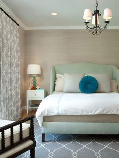 Calm.  Love the grasscloth and the headboard.