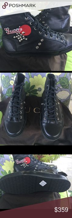 Gucci Leather Stud-Embellished Sneakers Men's black leather Gucci round-toe high-top sneakers with silver and pewter-toned hardware, embroidered logo and stud embellishments at right ankle, rubber soles and lace-up tie closures at top. Guaranteed Authentic! Gucci Shoes Sneakers