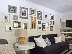 b photos in a mix-matched collage of frames on a white wall